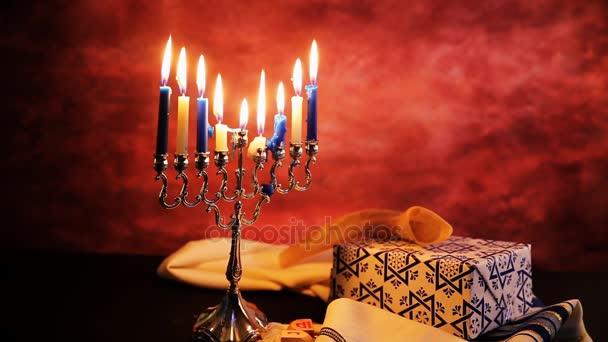 depositphotos_132245612-stock-video-jewish-holiday-hannukah-symbols-lighting