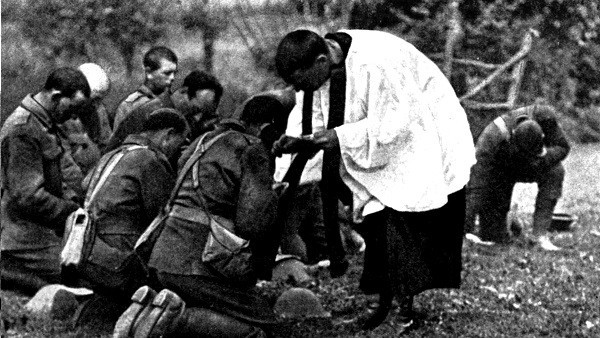 World War I: New Zealand troops taking Holy Communion administered by an Army chaplain in the open air