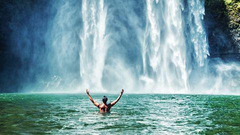 man-swimming-at-wailua-falls_5791893