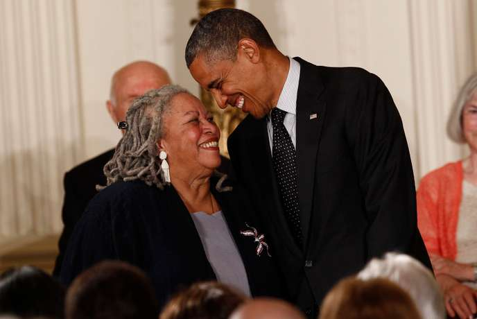 Novelist Morrison smiles with President Obama as he prepares to award her a 2012 Presidential Medal of Freedom at the White House in Washington