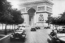 220px-Nazi-parading-in-elysian-fields-paris-desert-1940